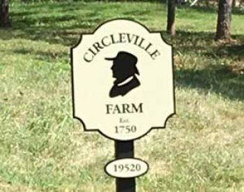 family farm sign